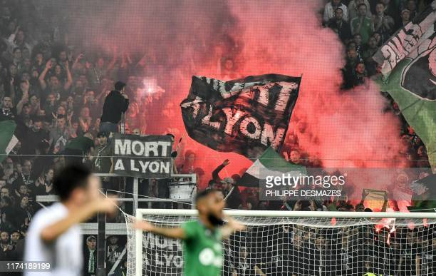 Saint-Etienne's fans cheer during the French L1 football match between AS Saint-Etienne and Olympique Lyonnais at the Geoffroy Guichard Stadium in...