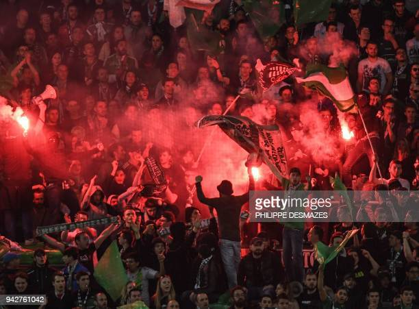 Saint-Etienne's fans cheer during the French L1 football match between AS Saint-Etienne and Paris Saint-Germain on April 6, 2018 at the...