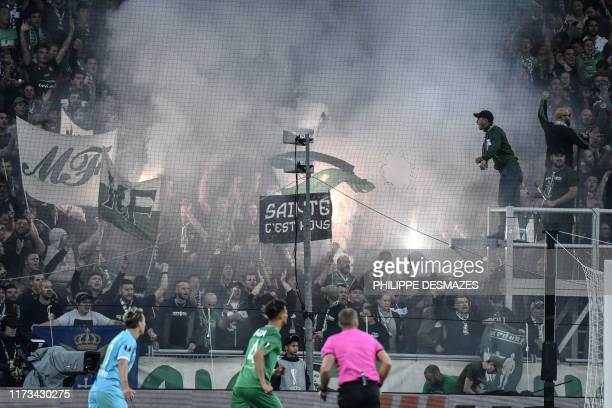 SaintEtienne's fans cheer for their team during the Europa League group I football match between AS SaintEtienne and VFL Wolfsburg on October 3 2019...