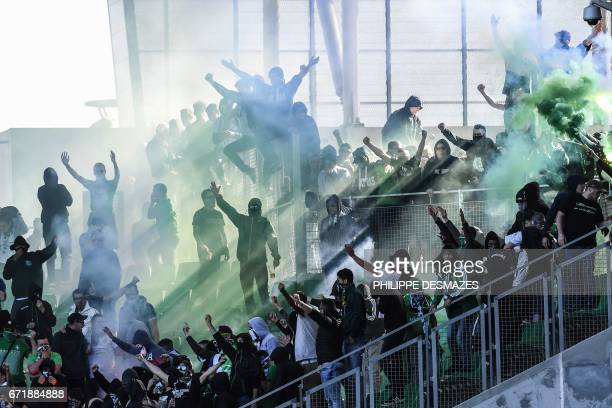 TOPSHOT SaintEtienne's fans invade the stadium during the French L1 football match played behind closed door between AS SaintEtienne and Stade...