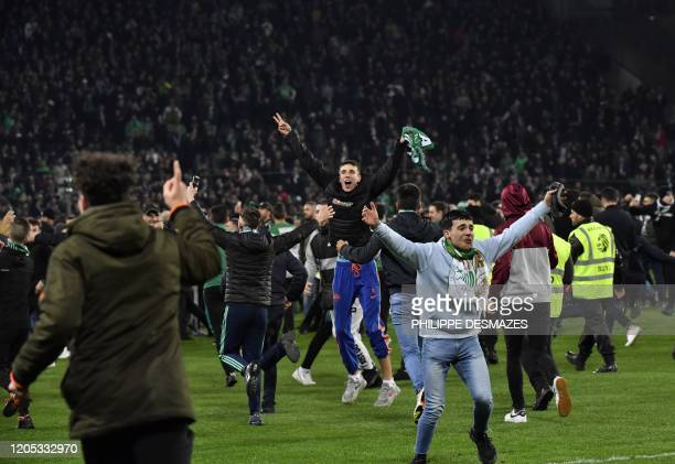 SaintEtienne's fans run on the field after the victory of SaintEtienne in the French Cup semifinal match between AS SaintEtienne and Stade Rennais FC...