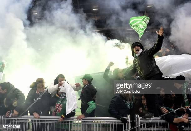 SaintEtienne's fans wave during the French L1 football match between AS SaintEtienne and Olympique Lyonnais on November 5 at the Geoffroy Guichard...