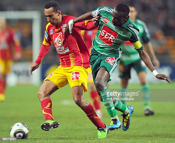 SaintEtienne's forward Laise Matuidi vies with Lens's forward Eduardo during the French Cup quarter final football match Lens vs SaintEtienne on...
