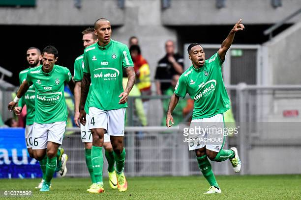 SaintEtienne's French defender Arnaud Nordin celebrates with his teamates after scoring a goal during the French L1 football match AS SaintEtienne vs...