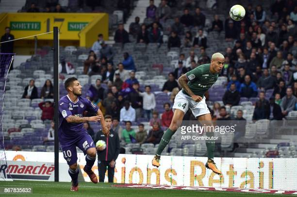 SaintEtienne's French defender Leo Lacroix jumps for the ball Toulouse's French forward Andy Delort during the French L1 football match between...