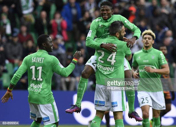 Saint-Etienne's French defender Loic Perrin celebrates with his teammates after scoring a goal during the French L1 Football match between AS...