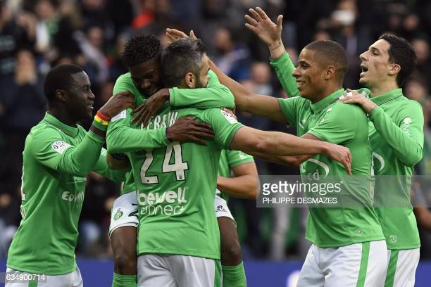 SaintEtienne's French defender Loic Perrin celebrates with his teammates after scoring a goal during the French L1 Football match between AS...
