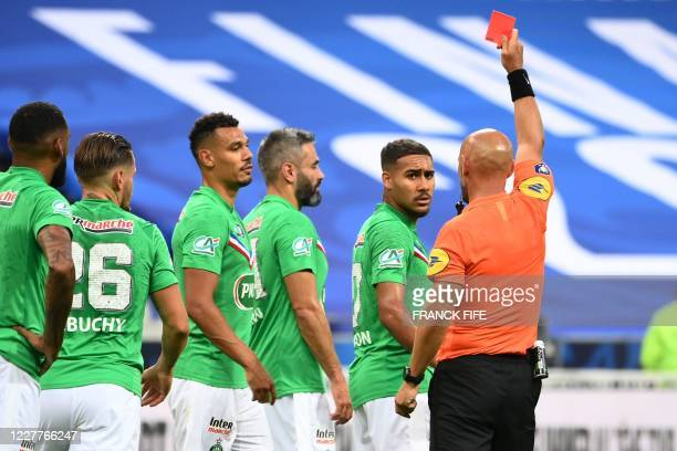Saint-Etienne's French defender Loic Perrin receives a rec card from French referee Amaury Delerue during the French Cup final football match between...