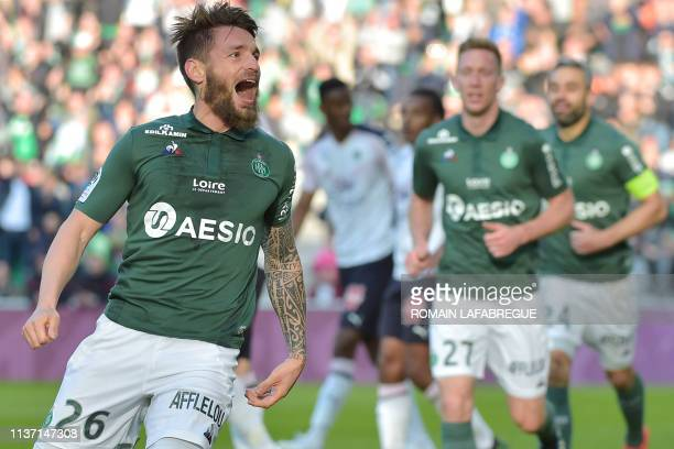 Saint-Etienne's French defender Mathieu Debuchy celebrates after scoring a goal during the French L1 football match between Saint-Etienne and...