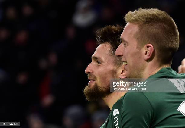 Saint-Etienne's French defender Mathieu Debuchy celebrates with teammates after scoring a goal during the French L1 football match between Lyon and...