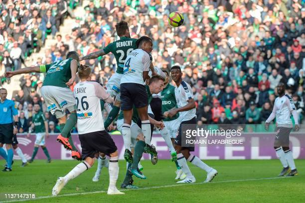 Saint-Etienne's French defender Mathieu Debuchy heads the ball and scores a goal during the French L1 football match between Saint-Etienne and...