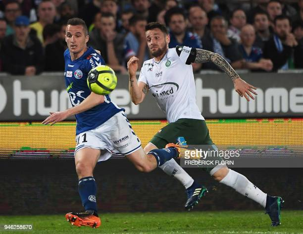 Saint-Etienne's French defender Mathieu Debuchy vies with Strasbourg's French midfielder Dimitri Lienard during the French L1 football match between...