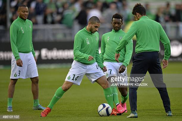 SaintEtienne's French defender PierreYves Polomat French forward Neal Maupay and forward JeanChristophe Bahebeck warm up prior to the French L1...