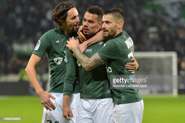 SaintEtienne's French defender thimothee Kolodziejczak celebrates with teammates after scoring a goal during the French L1 football match between...