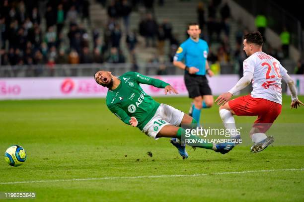 Saint-Etienne's French forward Arnaud Nordin is fouled by Nimes' French defender Florian Miguel during the French L1 football match between AS...