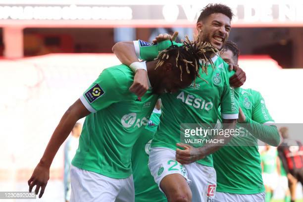 Saint-Etienne's French forward Charles Abi celebrates with teammates after scoring a goal during the French L1 football match between Nice and...