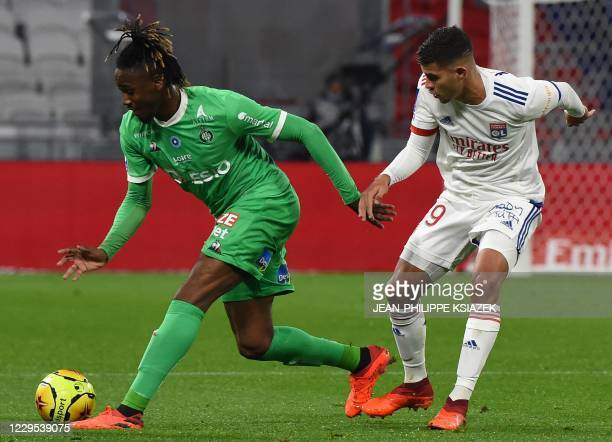 SaintEtienne's French forward Charles Abi fights for the ball with Lyon's Brazilian midfielder Bruno Soares during the French L1 football match...