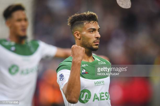 SaintEtienne's French forward Denis Bouanga celebrates after scoring a penalty kick during the French L1 football match between Bordeaux and...
