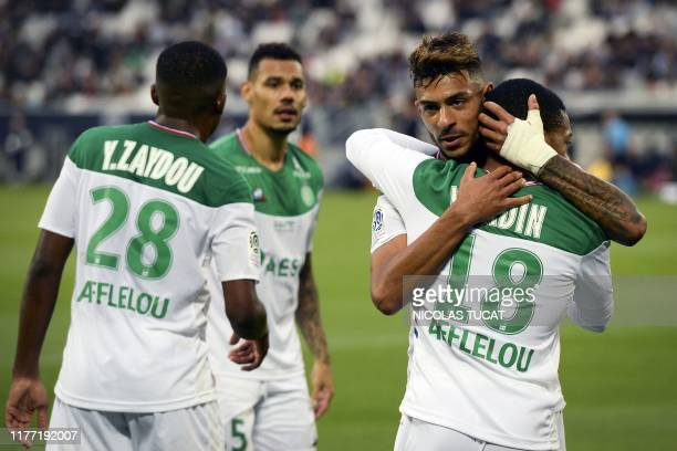 Saint-Etienne's French forward Denis Bouanga celebrates with teammates after scoring a penalty kick during the French L1 football match between...