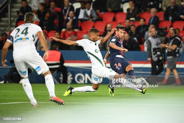 Saint-Etienne's French forward Kevin Monnet-Paquet vies for the ball with Paris Saint-Germain's Spanish defender Juan Bernat during the French L1...