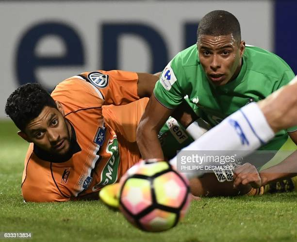 SaintEtienne's French forward Kevin MonnetPaquet vies with Auxerre's French goalkeeper Zacharie Boucher during the French Cup football match between...