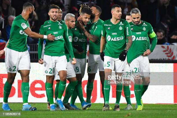 Saint-Etienne's French forward Lois Diony celebrates with teammates after scoring a goal during the French Ligue 1 football match between Stade...