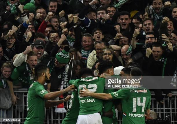 SaintEtienne's French forward Lois Diony is congratuled by teamates after scoring a goal during the French Cup semifinal match between AS...
