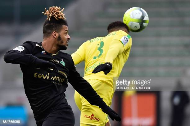 SaintEtienne's French forward Lois Diony looks at Nantes' Brazilian defender Diego Carlos heading the ball during the French L1 football match...