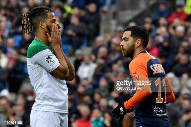 Saint-Etienne's French forward Lois Diony reacts after missing a goal opportunity next to Montpellier's French midfielder Teji Savanier during the...