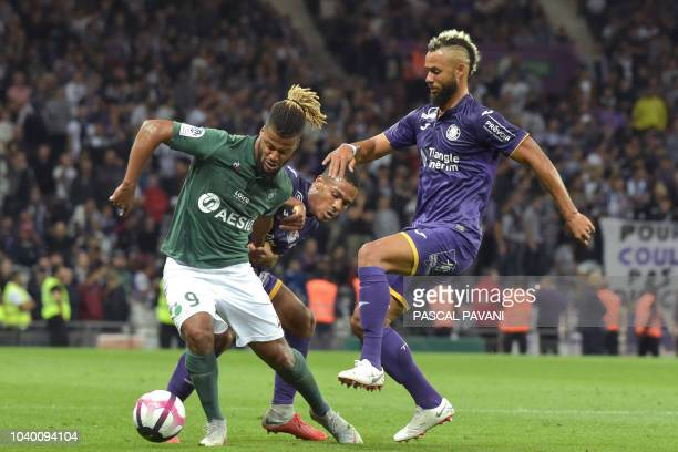 Saint-Etienne's French forward Lois Diony vies for the ball against Toulouse's Trinidadian midfielder John Bostock during day 7 of the French L1...