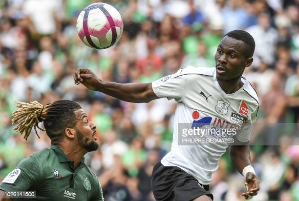 SaintEtienne's French forward Lois Diony vies with Amiens' Beninese defender Khaled Adenon during the French L1 football match between AS...
