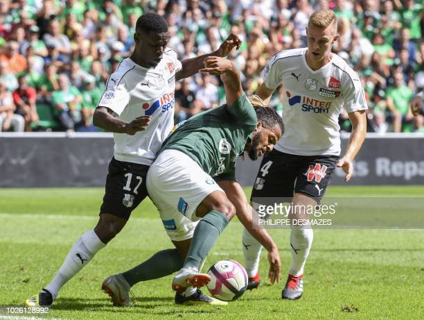 SaintEtienne's French forward Lois Diony vies with Amiens' French defender Bakaye Dibassy and Amiens' Swedish defender Emil Krafth during the French...