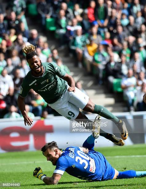 SaintEtienne's French forward Lois Diony vies with Anger's French goalkeeper Alexandre Letellier during the French L1 football match between...