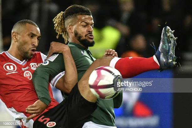 SaintEtienne's French forward Lois Diony vies with Reims' French defender Yunis Abdelhamid during the L1 football match AS SaintEtienne vs Stade de...