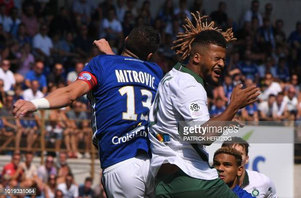 SaintEtienne's French forward Lois Diony vies with Strasbourg's Serbian defender Stefan Mitrovic during the French Ligue 1 football match between...