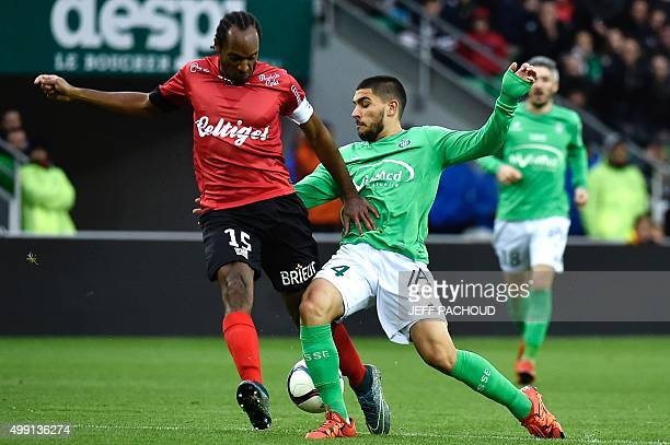 SaintEtienne's French forward Neal Maupay vies for the ball against Guingamp's French defender Jeremy Sorbon during the French L1 football match AS...