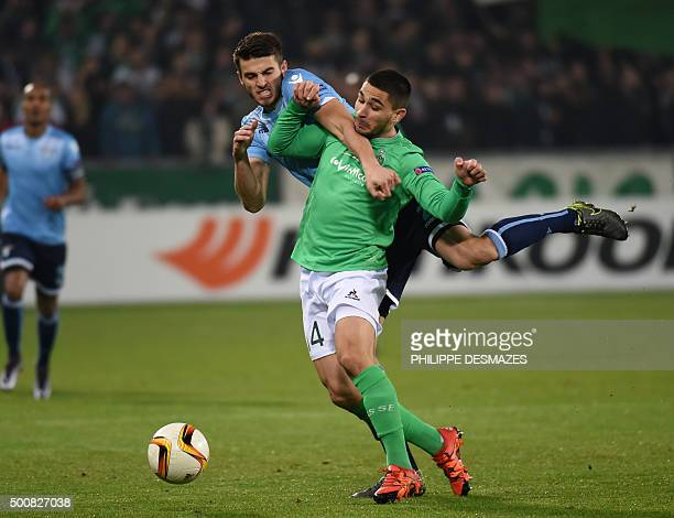 SaintEtienne's French forward Neal Maupay vies with Lazio's Dutch defender Wesley Hoedt during the Europa League football match between AS...
