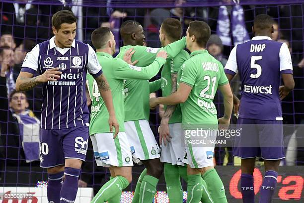 Saint-Etienne's French forward Nolan Roux celebrates with his teammates after scoring a goal during the French L1 football match between Toulouse and...