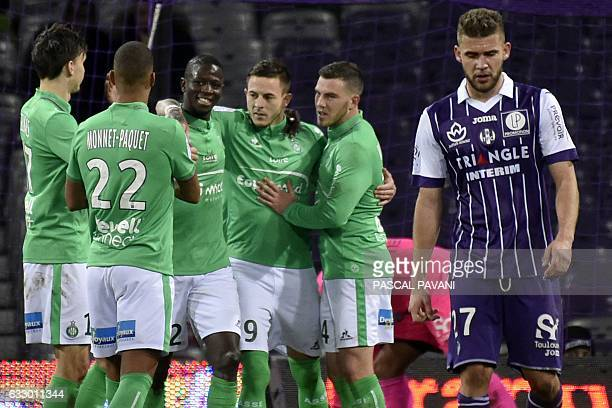 SaintEtienne's French forward Nolan Roux celebrates with teammates after scoring a goal during the French L1 football match between Toulouse and...