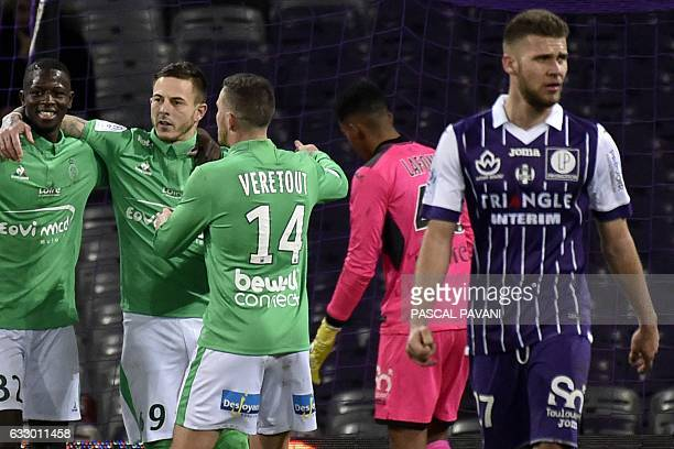 Saint-Etienne's French forward Nolan Roux celebrates with teammates after scoring a goal during the French L1 football match between Toulouse and...