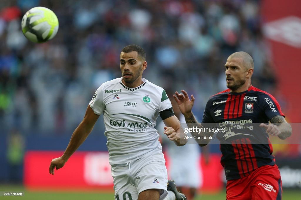 Saint-Etienne's French forward Oussama Tannane (L) vies with Caen's French midfielder Vincent Bessat (R) during the French L1 football match between Caen (SMC) and Saint-Etienne (ASSE) on August 12, 2017, at the Michel d'Ornano stadium, in Caen, northwestern France. /