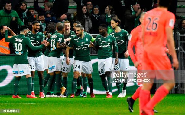 SaintEtienne's French forward PaulGeorges Ntep celebrates with teammates after scoring a goal during the French L1 football match between...