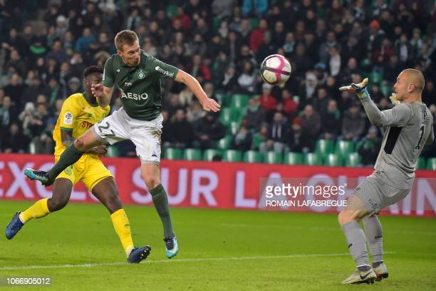 SaintEtienne's French forward Robert Beric heads the ball and scores a goal during the French L1 football match between SaintEtienne and Nantes on...