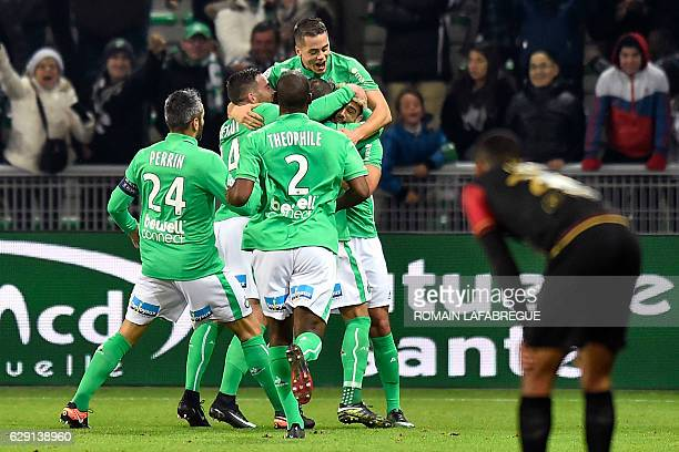 Saint-Etienne's French forward Romain Hamouma celebrates with teammates after scoring a goal during the French L1 football match between...
