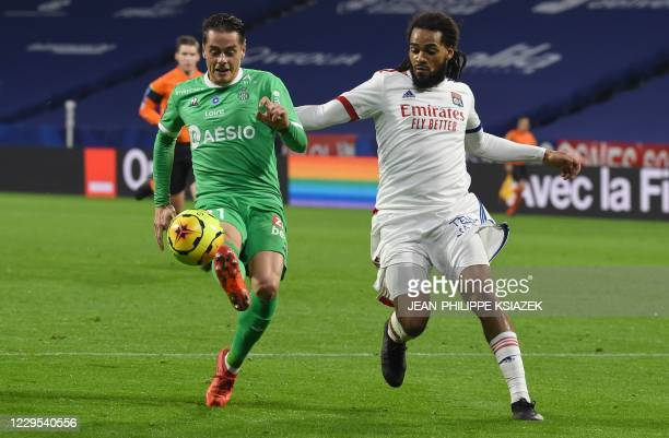 SaintEtienne's French forward Romain Hamouma fights for the ball withLyon's Belgian defender Jason Denayer during the French L1 football match...