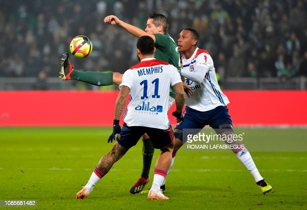 Saint-Etienne's French forward Romain Hamouma is challenged by Lyon's Dutch forward Memphis Depay and Lyon's Brazilian defender Marcelo Guedes Filho...