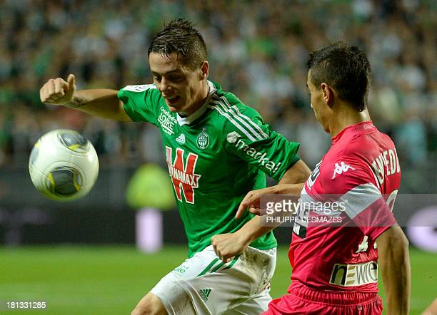 SaintEtienne's French forward Romain Hamouma vies with Toulouse's French forward Wissam Ben Yedder during the French L1 football match SaintEtienne...