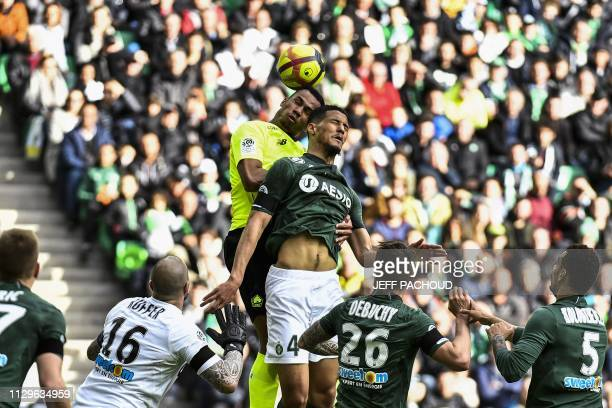 SaintEtienne's French forward William Saliba and Lille's Brazilian defender Gabriel Magalhaes jump for the ball during the L1 football match AS...
