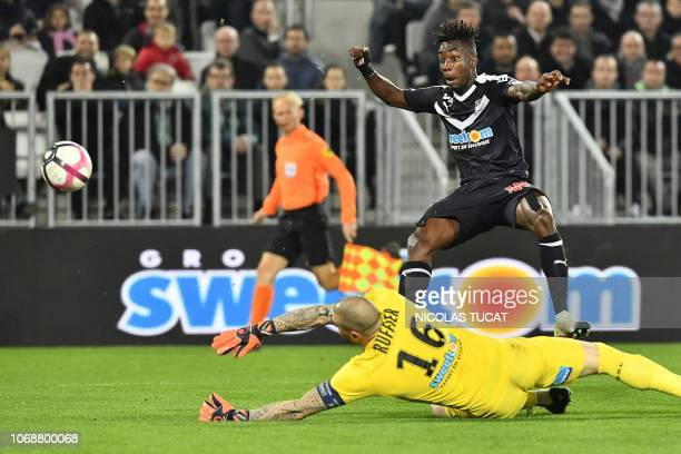 Saint-Etienne's French goalkeeper Stephane Ruffier dives in front of Bordeaux's French forward Yann Karamoh during the French L1 football match...