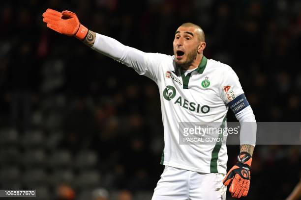 Saint-Etienne's French goalkeeper Stephane Ruffier gestures during the French League Cup round of 16 football match between Nimes Olympique and AS...